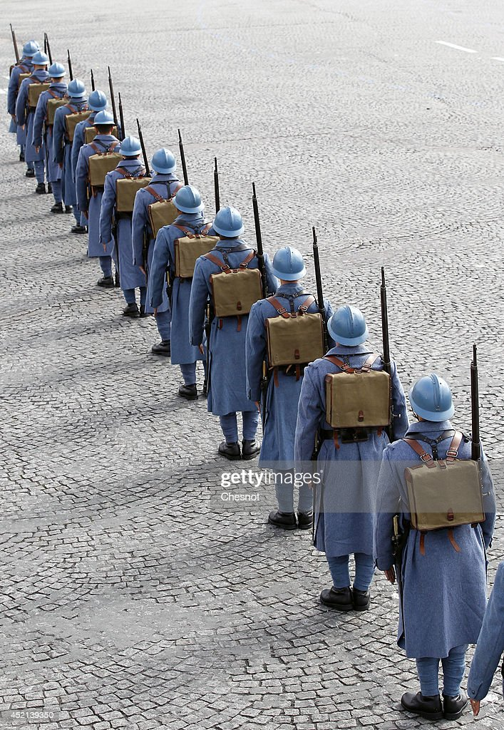 French soldiers wear WWI French soldiers 'Poilu' uniforms during the annual Bastille Day military parade on the Place de la Concorde in Paris, on July 14, 2014. France has issued an unprecedented invitation to all 72 countries involved in World War I to take part in its annual Bastille Day military parade.