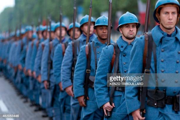 French soldiers wearing WWI French soldiers 'Poilu' uniforms parade on July 12 2014 on the Champs Elysees avenue in Paris during a rehearsal of the...