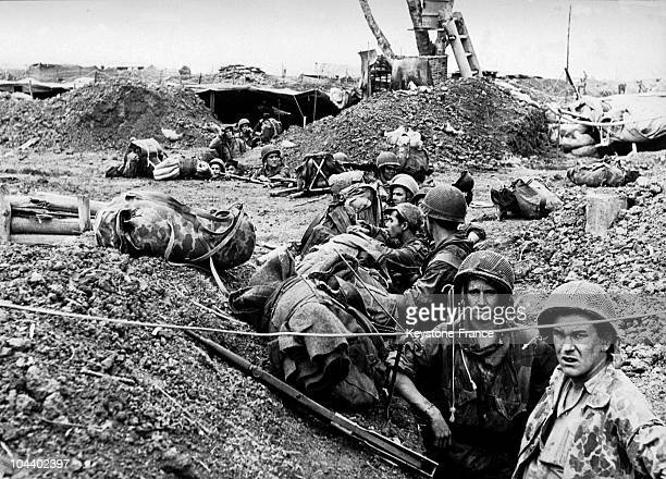 French soldiers who have been parachuted in as reinforcements are moving around in the trenches to take new positions during violent artillery...
