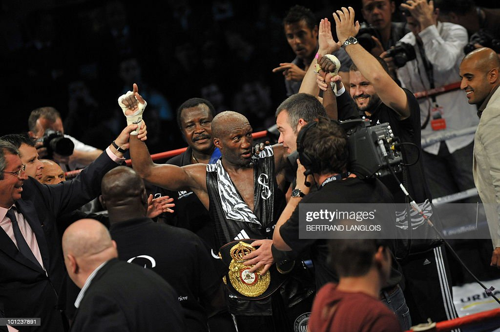 French Souleymane Mbaye (C) celebrates after defeating Canadian Antonin Decarie following their WBA World Championship Welterweight match at the Marcel Cerdan hall in Levallois, near Paris, on May 28, 2010. Mbaye defeated Decarie.