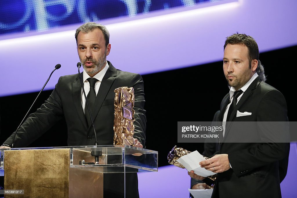 French sound editor Antoine Deflandre (L) speaks next to French sound editor Germain Boulay (R), after they received the Best Sound Editing award for French director Florent-Emilio Siri's film 'Cloclo' during the 38th Cesar Awards ceremony on February 22, 2013 at the Chatelet theatre in Paris.