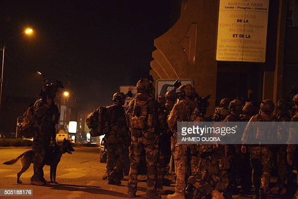 French special forces gather by the Labour Ministry building in the surroundings of the Splendid hotel during an attack on both the hotel and a...