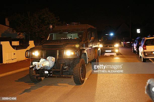 French special forces RAID vehicle leaves after an assault on June 14 2016 in Magnanville 45 kms west of Paris A man was shot dead during a dramatic...