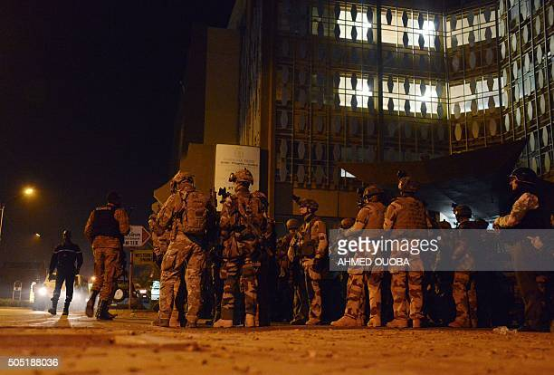 French special forces take position by the Labour Ministry building in the surroundings of the Splendid hotel and a restaurant during an attack on...