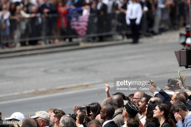 French spectators during the traditional Bastille day military parade on the ChampsElysees on July 14 2017 in Paris France Bastille Day the French...