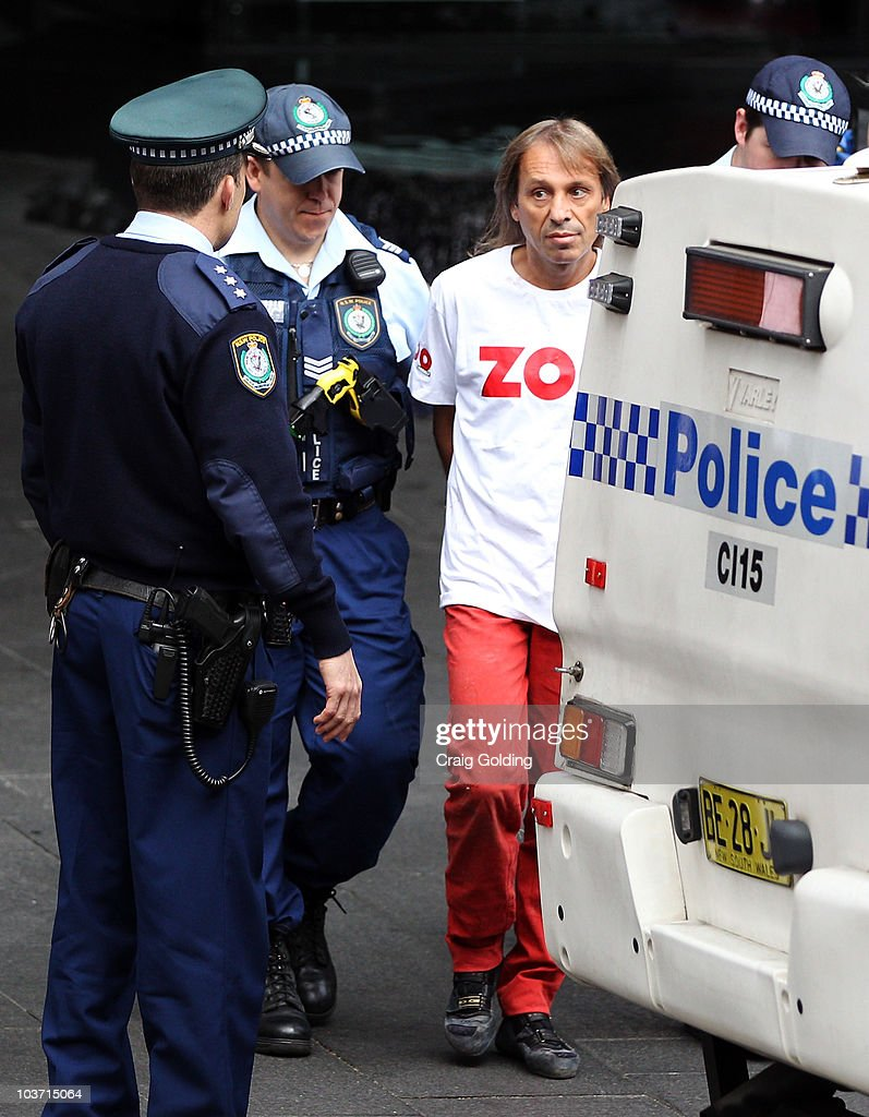 'French Spiderman' <a gi-track='captionPersonalityLinkClicked' href=/galleries/search?phrase=Alain+Robert+-+Climber&family=editorial&specificpeople=769748 ng-click='$event.stopPropagation()'>Alain Robert</a> is arrested by police after climbing the 57-storey Lumiere building on August 30, 2010 in Sydney, Australia. Robert, who has scaled more than 85 structures around the world, successfully climbed the Lumiere building in 25 minutes.