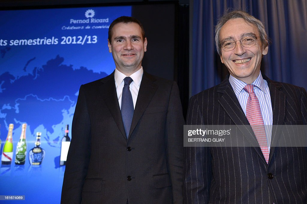 French spirit Pernod Ricard group's managing Director, Alexandre Ricard (L) and Vice-President and General Director Pierre Pringuet (R) pose before a press conference to present the 2012-2013 half-yearly results, on February 14, 2013 in Paris.
