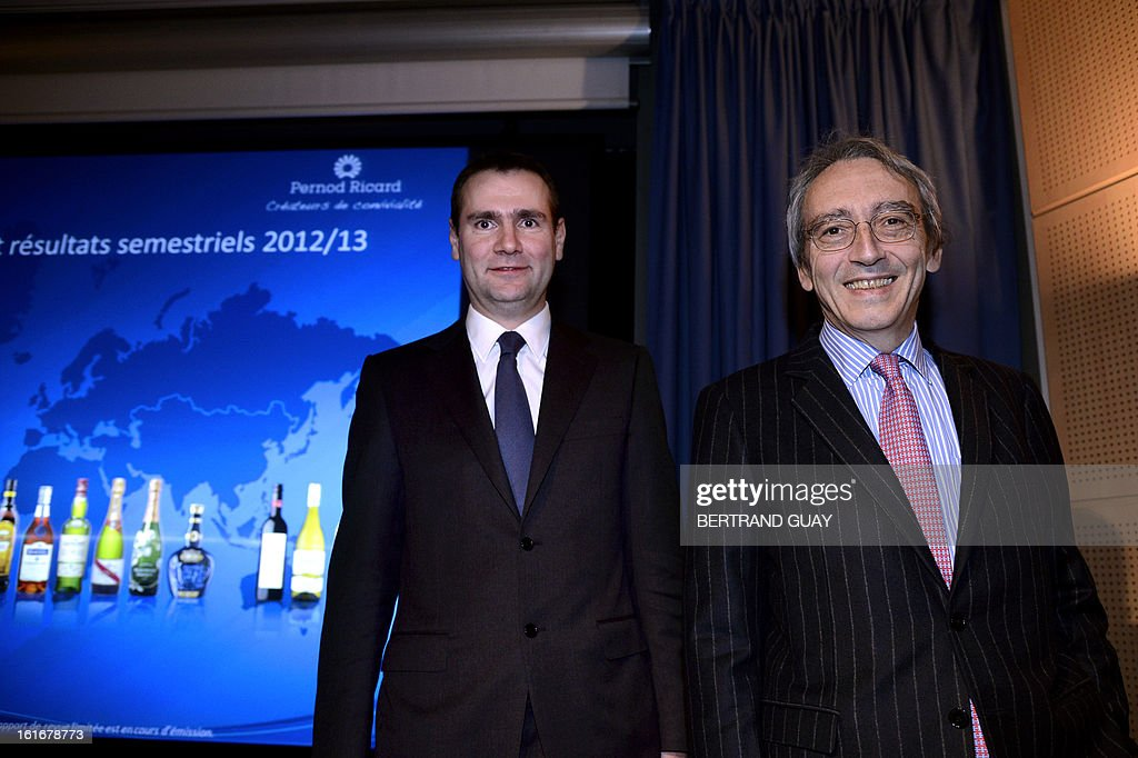 French spirit Pernod Ricard group's managing Director, Alexandre Ricard (L) and Vice-President and General Director Pierre Pringuet (R) attend a press conference to present the 2012-2013 half-yearly results, on February 14, 2013 in Paris.