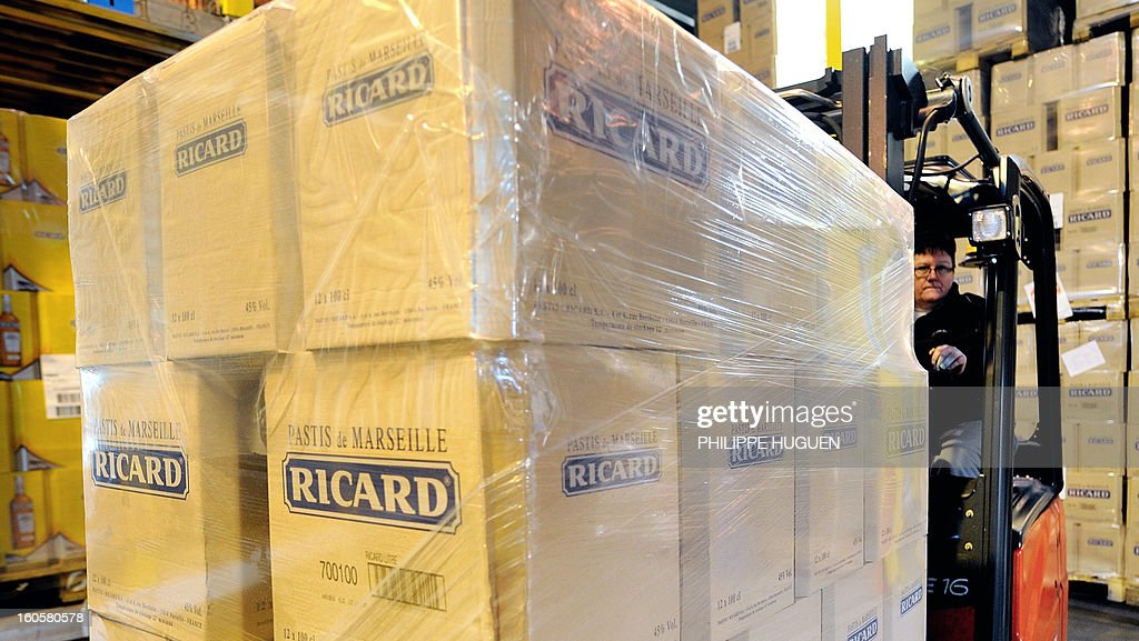 French spirit Pernod-Ricard boxes of star aniseed-based spirit Ricard are pictured on January 31, 2013 in Vendeville, northern France. The famous star anise spirit Ricard was created in 1932 by French Paul Ricard and became Pernod-Ricard group in 1975.