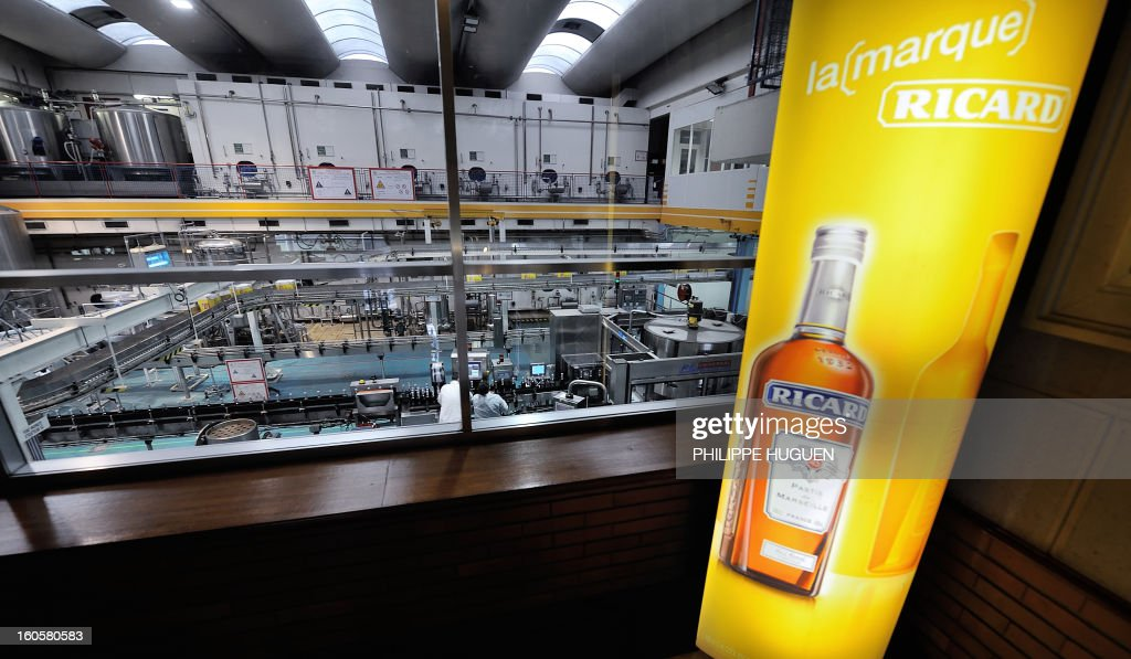 French spirit Pernod-Ricard chain of bottling is pictured on January 31, 2013 in Vendeville, northern France. The famous star anise spirit Ricard was created in 1932 by French Paul Ricard and became Pernod-Ricard group in 1975.