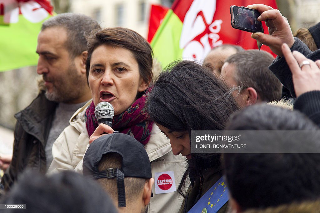 French spokeswoman of Lutte Ouvriere (Workers' Struggle) far left party Nathalie Arthaud gives a speech as she takes part with employees of the Virgin Megastore in a demonstration in front of the shop on the Champs-Elysees avenue, on January 29, 2013 in Paris. Megastore music and book unit direction, which is known in France as a 'culture' retailer, annouced two weeks ago its insolvency. Originally started by Richard Branson, the British billionaire and chairman of the Virgin Group, the Virgin megastores were bought by the French Lagardere group in 2001 before French-American businessman Walter Butler became the majority shareholder. Butler announced on January 20, 2013, its failure to relaunch the stores. AFP PHOTO / LIONEL BONAVENTURE