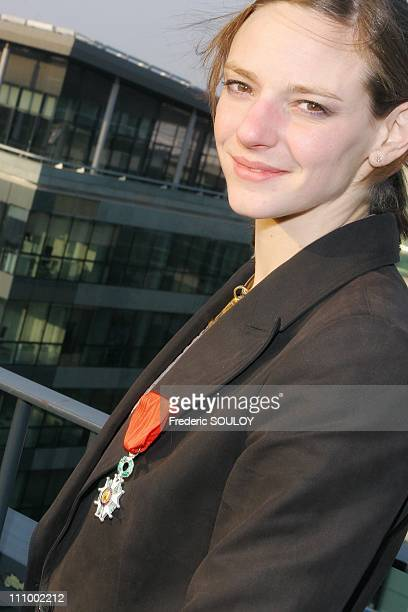 French sports minister Jean Francois Lamour awards the Legion Honour medal to Virginie Dedieu in Paris France on April 11th 2007 Virginie Dedieu...