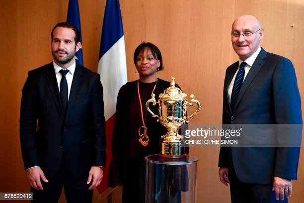 French Sports Minister Laura Flessel poses alongside French Rugby president Bernard Laporte and former French rugby player Frederic Michalak with The...