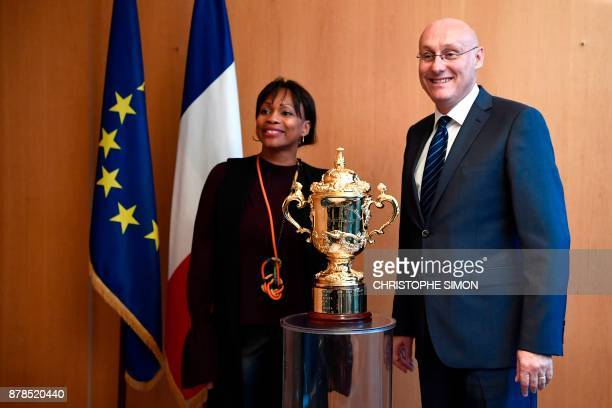 French Sports Minister Laura Flessel poses alongside French Rugby president Bernard Laporte and The Webb Ellis Cup The World Cup of Rugby Union at...