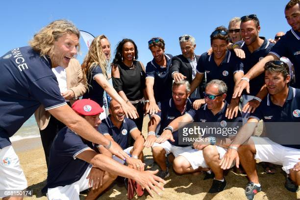 French Sports Minister Laura Flessel poses with members of the France's national surf team on May 25 2017 on the beach in Biarritz southwestern...