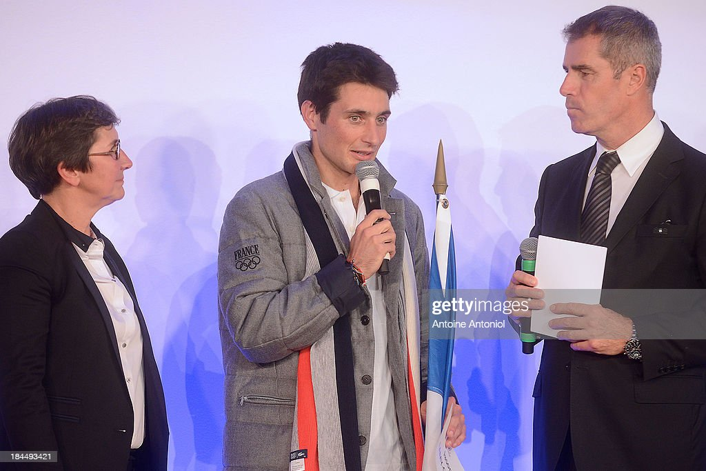 French Sports Minister Valerie Fourneyron (L) and Luc Tardif, head of the French delegation for the 2014 Winter Olympics, listens to French nordic combined ski champion Jason Lamy Chappuis (C) after being chosen as his countries flag bearer for the Sochi 2014 Winter Olympics on October 14, 2013 in Paris, France.