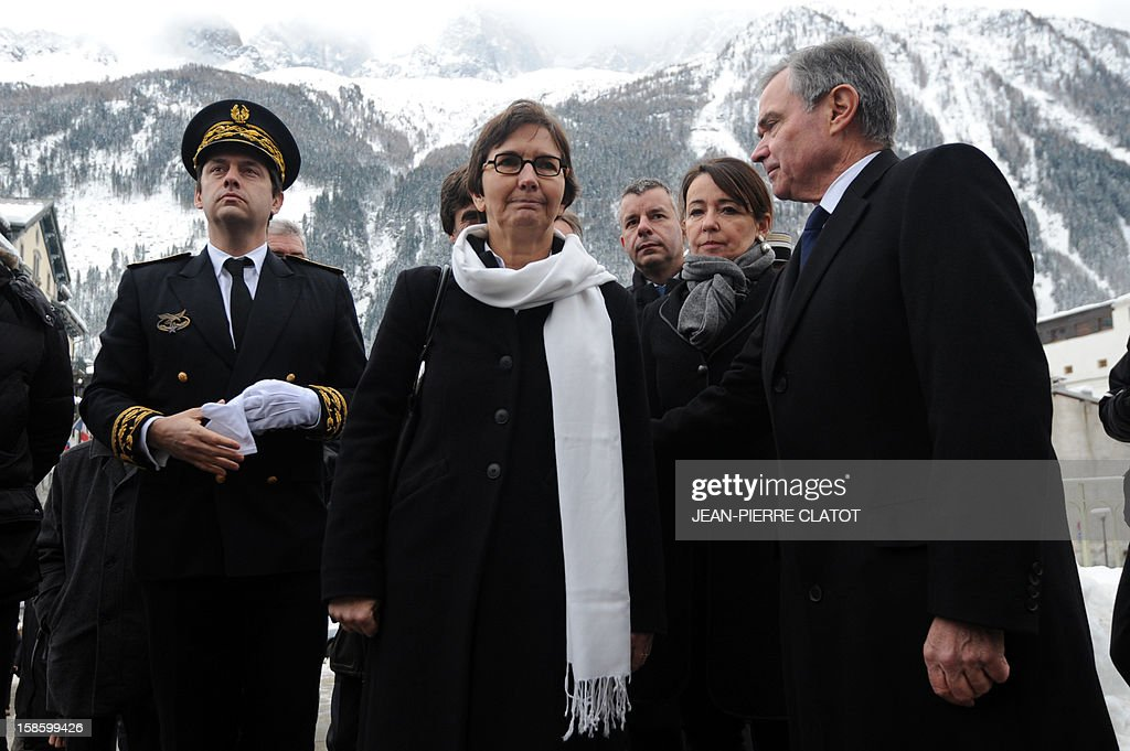 French Sports minister Valerie Fourneyron (C), Haute-Savoie prefect Georges François Leclerc (L) and local MP Bernard Accoyer (R) arrive to attend the funeral ceremony of French climber Maurice Herzog, on December 20, 2012 at the Saint-Michel church in Chamonix, French Alps. Maurice Herzog, the French climber who conquered Annapurna in the first recorded ascent of a peak above 8,000 metres, has died at the age of 93, on December 13.