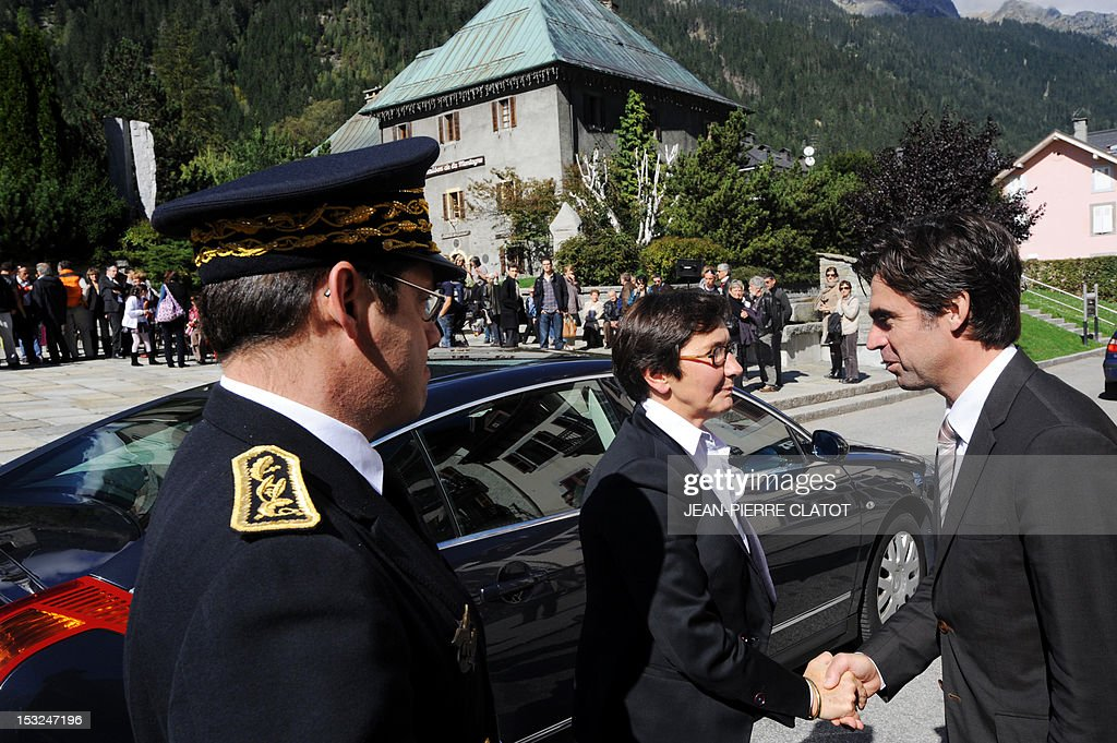 French Sports Minister Valerie Fourneyron (C) is welcomed by Chamonix's Mayor, Eric Fournier (R) as she arrives to attend a memorial ceremony to pay tribute to the victims of the last week avalanche on Nepal's Manaslu mountain, on October 2, 2012, in Chamonix, that is considered the birthplace of European alpinism and the home of most of the French climbers killed. The four French -- two guides and two clients -- were among eight people killed after an avalanche swept through their camp on the side of the 8,156-metre (26,759-foot) Himalayan mountain, just hours before the alpinists were to make an attempt to reach the peak's summit.