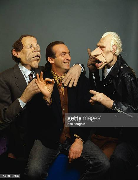 French standup comedian and voice imitator Yves Lecoq with puppets of the TV show Les Guignols de l'Info