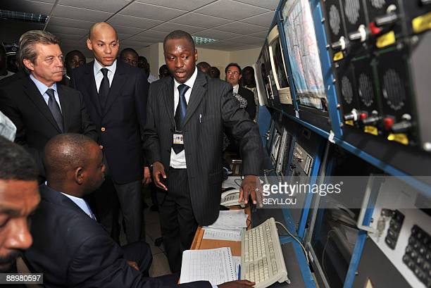 French State Secretary for Cooperation Alain Joyandet visits with Senegalese Transport Minister Karim Wade on July 11 2009 the technical department...