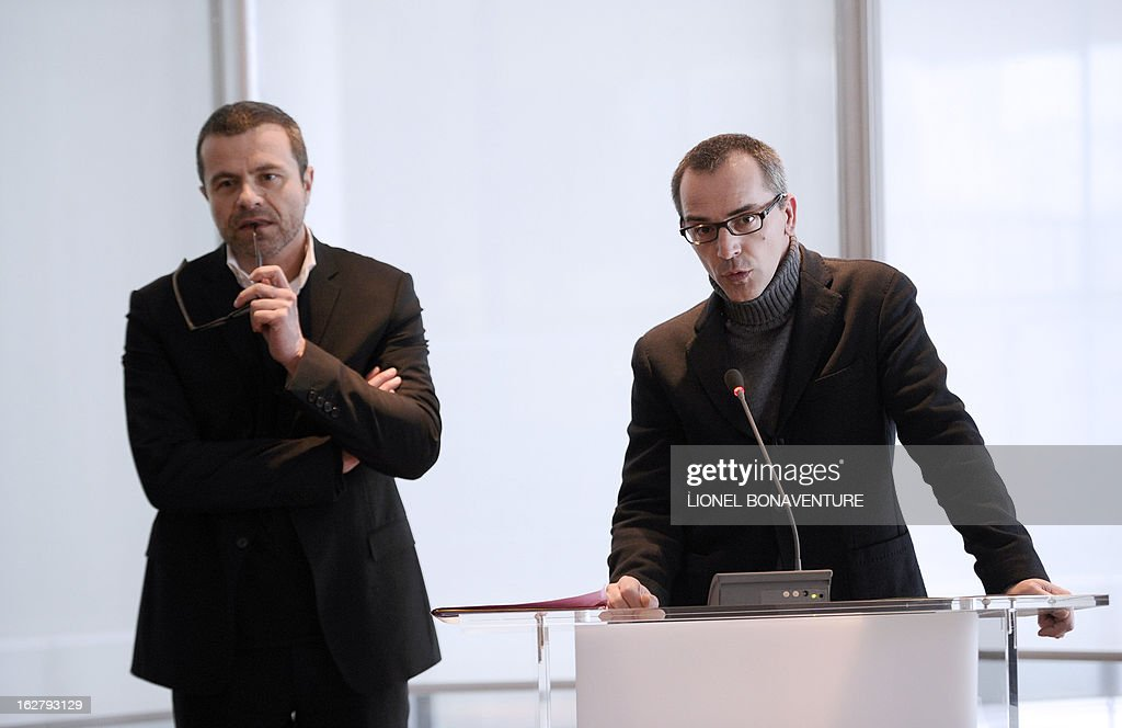 French state-run television group 'France Televisions' director of the programs for 'France 3' channel, Thierry Langlois (R) addresses beside 'France Televisions' news director Thierry Thuillier on February 27, 2013 at the group's headquarters in Paris during a presentation of the 'Grand Soir 3' daily evening news TV show starting from March 25.