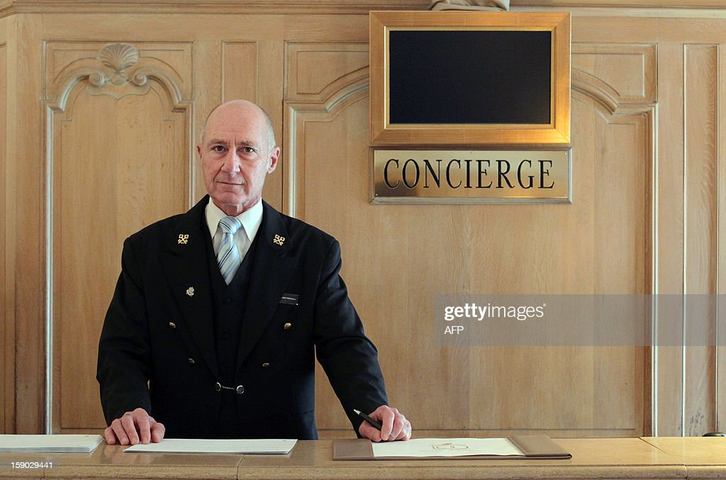 French Stephane Fanciulli, chief concierge of the Intercontinental Carlton Hotel, poses behind the reception desk of the hotel on January 4, 2013 in Cannes, southeastern France.