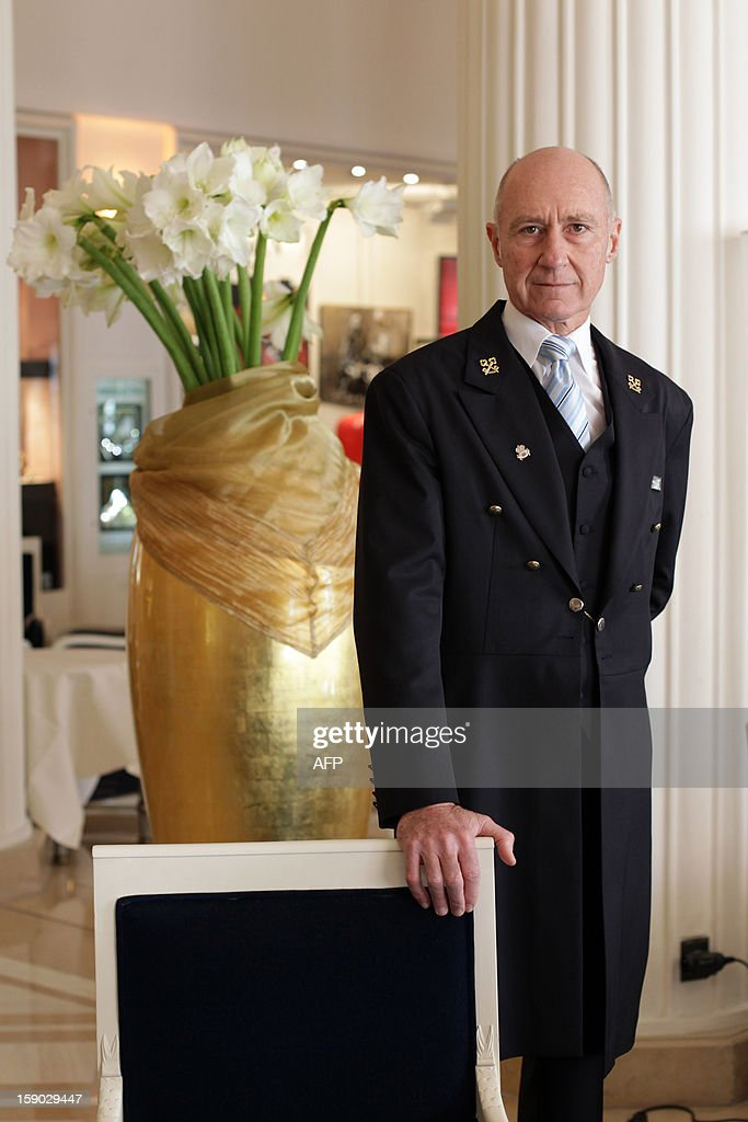 French Stephane Fanciulli, chief concierge of the Intercontinental Carlton Hotel, poses in the hotel lobby on January 4, 2013 in Cannes, southeastern France. AFP PHOTO / JEAN CHRISTOPHE MAGNENET