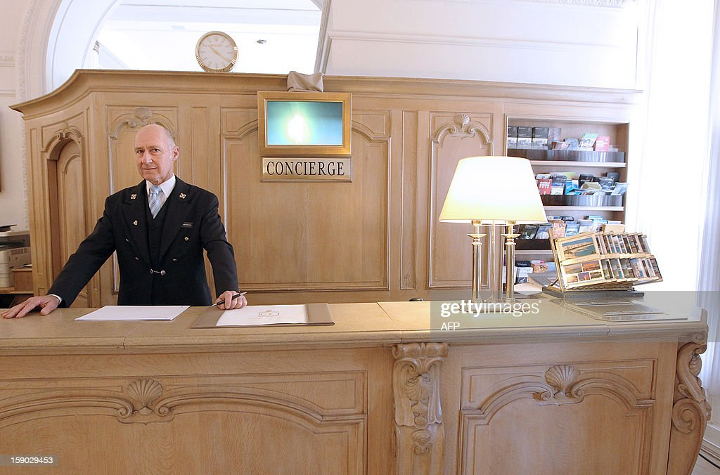 French Stephane Fanciulli, chief concierge of the Intercontinental Carlton Hotel, poses behind the reception desk of the hotel on January 4, 2013 in Cannes, southeastern France. AFP PHOTO / JEAN CHRISTOPHE MAGNENET