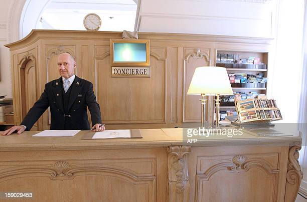 French Stephane Fanciulli chief concierge of the Intercontinental Carlton Hotel poses behind the reception desk of the hotel on January 4 2013 in...