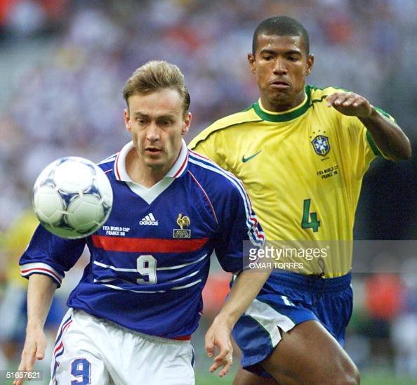French Stephane Guivarc'h is challenged by Brazilian Junior Baiano 12 July at the Stade de France in SaintDenis near Paris during the 1998 Soccer...