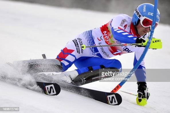 French Steve Missilier competes during the Men Slalom race at the Alpine ski World Cup finals on March 17 2013 in Lenzerheide AFP PHOTO / FABRICE...