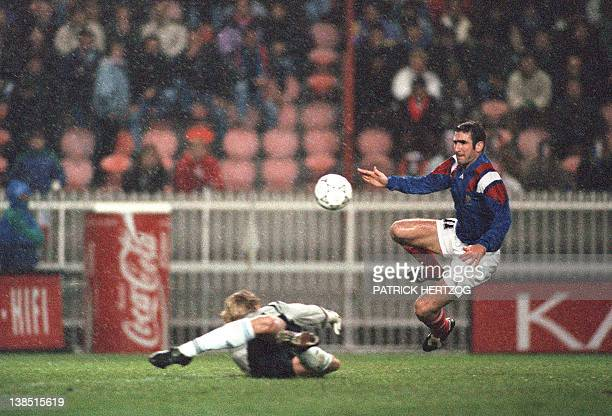 French striker Eric Cantona scores the second goal past Finnish goalkeeper Kari Laukkanen during the qualifying match for the Soccer World Cup...