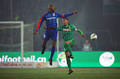 French striker Nicolas Anelka of Shanghai Shenhua clashes with opponent Xu Liang of Beijing Guoan during the Chinese Super League match at Workers...