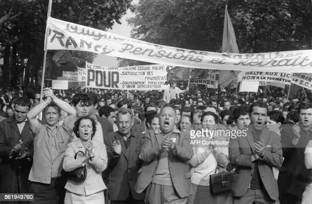 French strikers clap their hands and shout slogans as they take part in the big demonstration called by the CGT union in Paris 29 May 1968 during the...