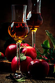 French strong golden alcohol drink from apples, rustic still life, selective focus