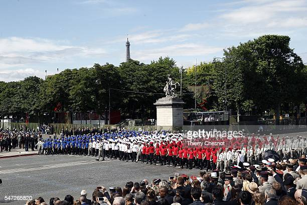 French students walks on the Place de la Concorde after marching down the ChampsElysees avenue during the annual Bastille Day military parade on July...