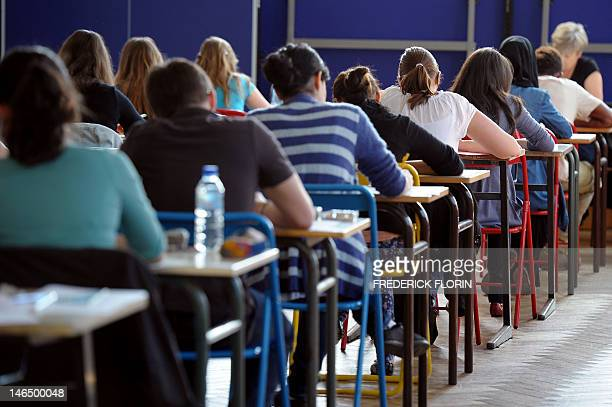 French students work on the test of Philosophy as they take the baccalaureat exam on June 18 2012 at the Pasteur high school in Strasbourg eastern...