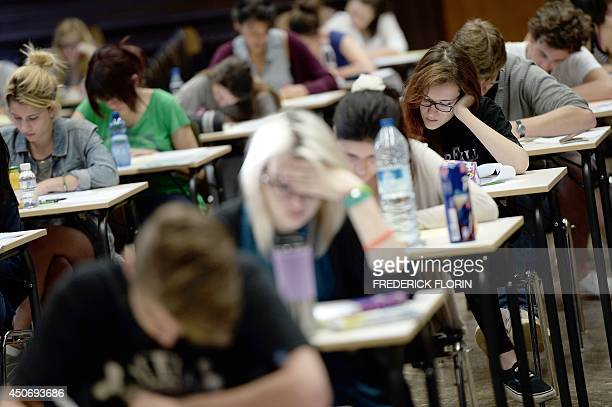 French students work on the test of philosophy as they take the baccalaureat exam on June 16 2014 at the Fustel de Coulanges high school in...