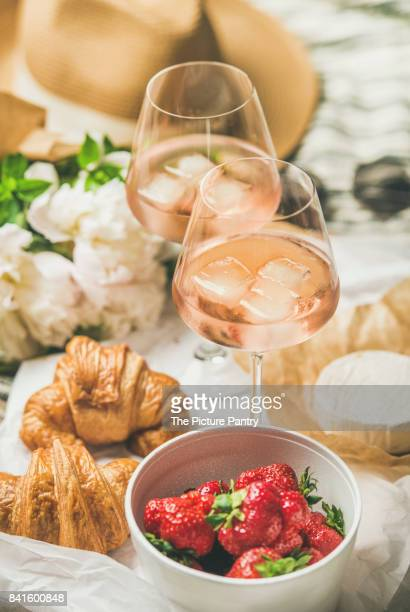 French style romantic summer picnic setting with rose wine