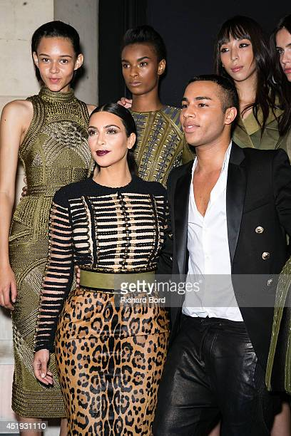French Stylist Olivier Rousteing poses with Kim Kardashian and her sister Kendall Jenner and Balmain Army models Binx Walton Ysaunny Brito Issa Lish...