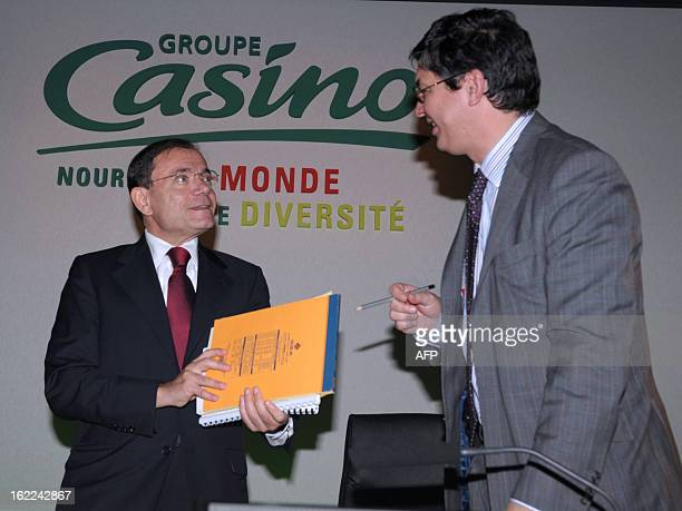 French supermarket and retail group Casino Chairman and CEO JeanCharles Naouri talks with CFO Antoine Giscard d'Estaing after presenting the group's...
