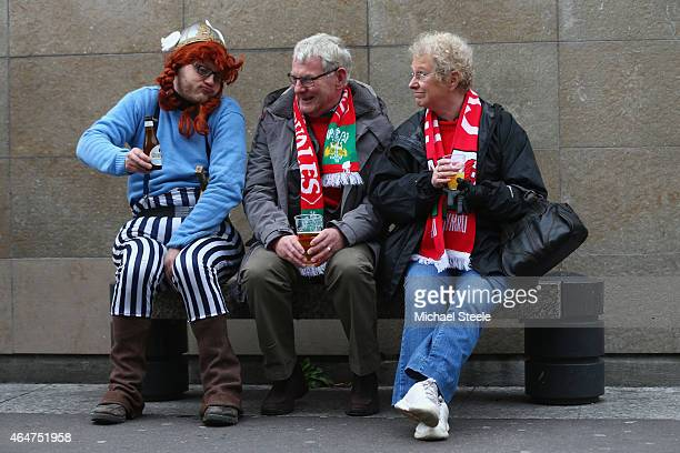French supporter dressed as Asterix chats with two fans of Wales ahead of the RBS Six Nations match between France and Wales at the Stade de France...