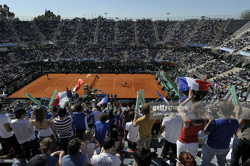 French supporters cheer during the Davis Cup quarterfinals tennis match between Argentine tennis player Juan Monaco and French tennis player Jo-Wilfried Tsonga at Mary Teran de Weiss stadium in Roca Park in Buenos Aires on April 7, 2013.