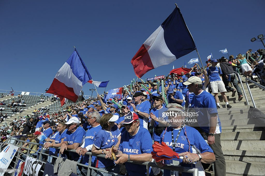 French supporters cheer during the Davis Cup quarterfinals tennis match between Argentine tennis player Juan Monaco and French tennis player Jo-Wilfried Tsonga at Mary Teran de Weiss stadium in Roca Park in Buenos Aires on April 7, 2013. AFP PHOTO / JUAN MABROMATA