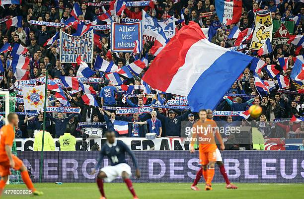 French supporters cheer for their team during the international friendly match between France and the Netherlands at Stade de France on March 5 2014...