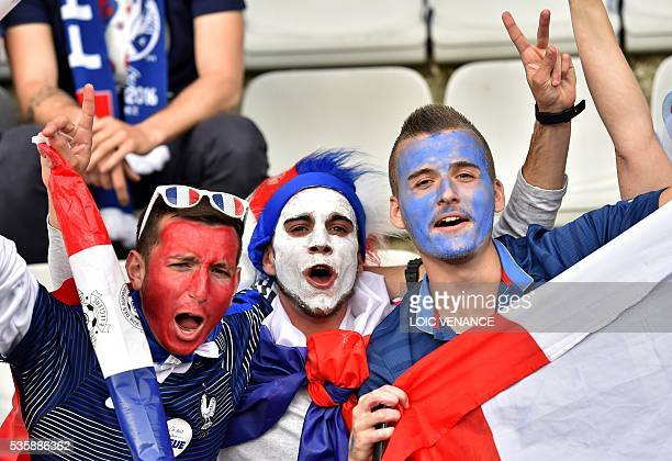 French supporters cheer prior to the International friendly football match between France and Cameroon at the Beaujoire stadium in Nantes western...