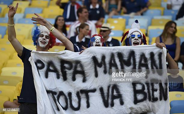 French supporters hold a banner reading 'Dad Mum everything is all right' prior to the start of a Group E football match between Ecuador and France...