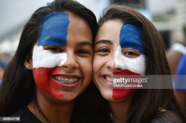 French supporters pose prior to watch a Group E football match between Switzerland and France on a giant screen in Copacabana in Rio de Janeiro...