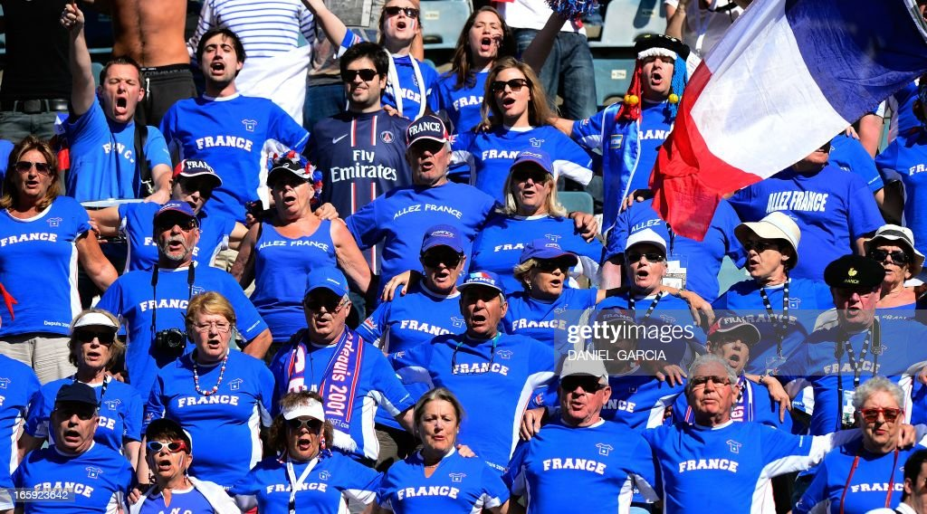 French supporters sing their national anthem during the Davis Cup quarterfinals tennis match between Argentine tennis player Juan Monaco and French tennis player Jo-Wilfried Tsonga at Mary Teran de Weiss stadium in Roca Park in Buenos Aires on April 7, 2013.