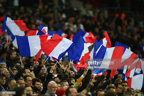 French supporters wave the national flags prior to the International Friendly match between England and France at Wembley Stadium on November 17 2015...